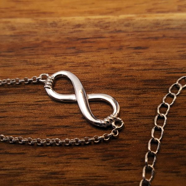Infinity Sterling Silver Necklace thehouseofjd.com