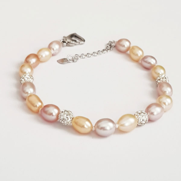 10 Day Refund, Return and Exchange policy 1 Year Limited warranty for: Multi Colour Drop Pearl Necklace, Earring and Bracelet Set With Glitter Ball AAA Grade Pearl Free Delivery in South Africa. NOTE: Unlike other common Pearls ours stand out. AAA GRADE which is known for highest quality and luster high shine finishes. DESCRIPTION: What every needs in her jewellery closet is her pearl magical moment. Add a pop of unique pearl colour to your collection. Featuring a sterling silver necklace and bracelet set with some freshwater pearls and a blend of sparkling glitter balls that will dazzle you anytime. A string of soft calm colours with a delicate chain that dangles beautifully and gracefully around your neck and wrist. Since pearls are trendy, you can pair this gem with almost any fashion vibe. Rock it with a pair of jean or you can flaunt this gem with a cocktail dress to celebrate that special event of a life time.
